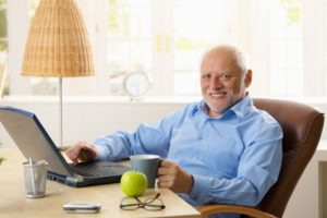 man happy at computer